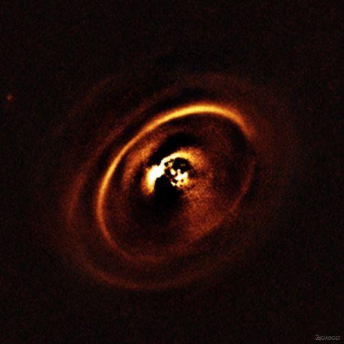 Астрономы увидели процесс зарождения планет (4 фото)